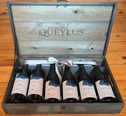 Legacy gift set, six bottles of wine laying down in a gray wooden box